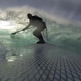 SUP surfing big waves at Todos Santos