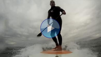 Stand up paddle board surfing at Sunset beach in Los Angeles, CA