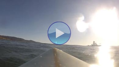 Stand up paddle board surfing at Mavericks in Half Moon Bay, CA